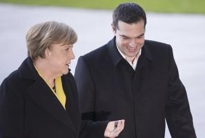 German Chancellor Merkel and Greek Prime Minister Tsipras review honour guard in Berlin