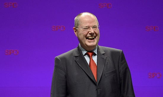 Steinbrueck SPD top candidate for the 2013 German general elections laughs after his speech during Lower Saxony state election campaign in Emden