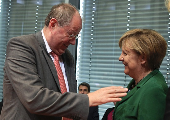 German Chancellor Merkel talks with former Finance Minister Steinbrueck before session of the EU committee of the German Lower House of Parliament, the Bundestag, in Berlin