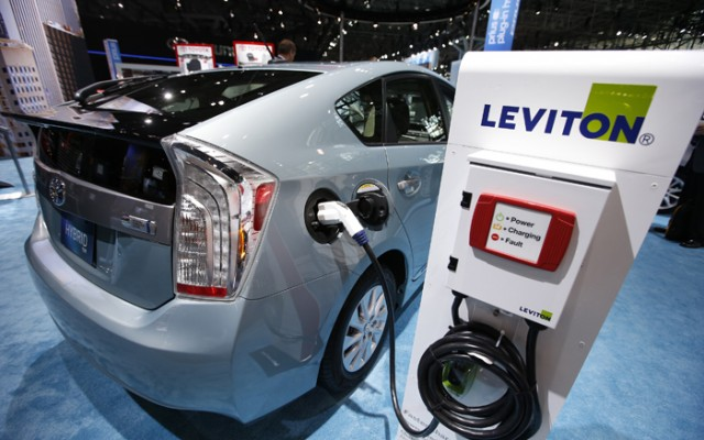 2013 Toyota Prius plug-in Hybrid car is seen plugged into Leviton charging station at Toyota display during a media preview at 2013 New York International Auto Show in New York