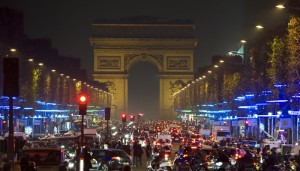 Environmentally-friendly holiday lights hang from the lower branches of trees to decorate the Champs Elysees in Paris