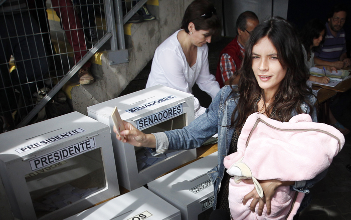 Former Chilean student movement leader Camila Vallejo casts her ballot during the presidential election in Santiago