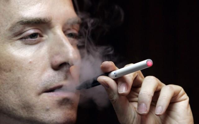Scott Fraser, vice president of SBT (Holdings) Ltd., demonstrates an e-cigarette in Hong Kong