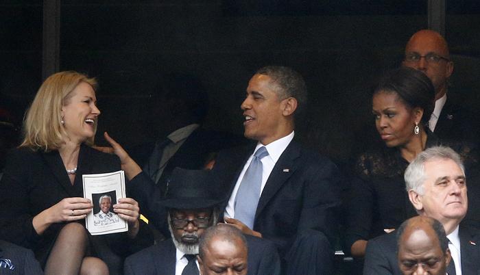 U.S. President Obama shares a moment with Denmark's PM Thorning-Schmidt during memorial service for Mandela in Johannesburg