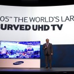 Joe Stinziano, executive vice president of Samsung Electronics of America, introduces a 105-inch, curved UHD television during the Consumer Electronics Show (CES), in Las Vegas