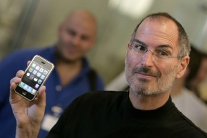 Apple Chief Executive Steve Jobs holds the new iPhone at the Apple store in central London