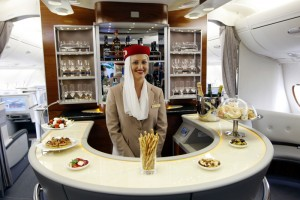 Flight attendant poses at bar in business class section of Emirates' Airbus A380 in New York