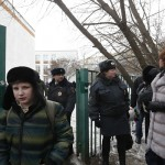 Interior Ministry members evacuate people after an armed student took hostages at a high school on the outskirts of Moscow
