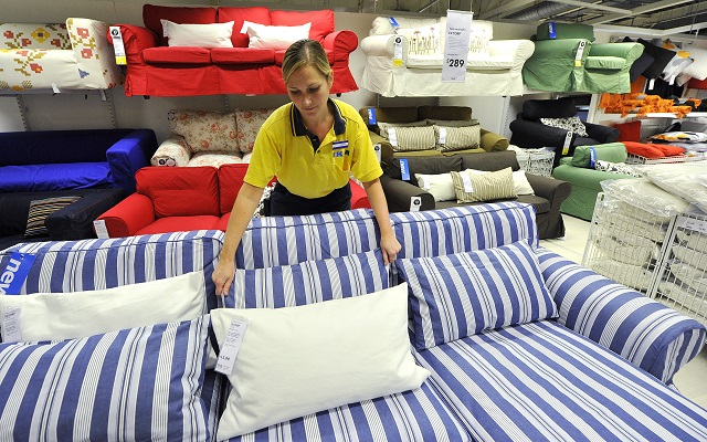 An Ikea employee works at the Wembley branch of the Swedish international furniture and home accessories company in west London