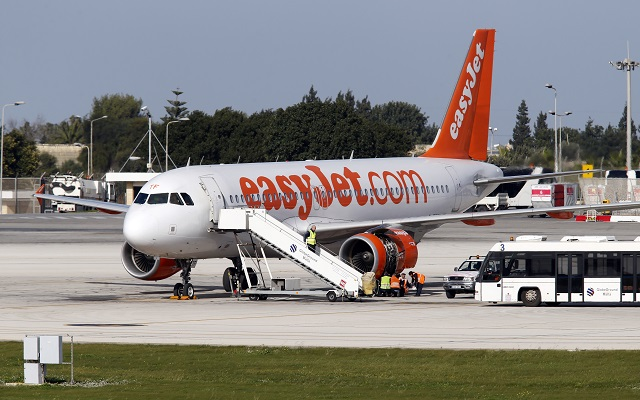 Aircraft technicians examine the engine of an EasyJet plane which suffered an engine failure six minutes into a flight to London Gatwick at Malta International Airport, outside Valletta