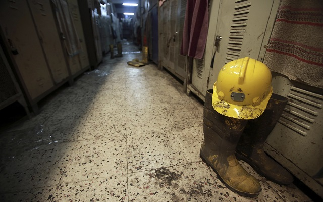 A boot and a helmet are seen in a changing room after a mining disaster in Soma