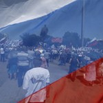 Participants are seen through a Russian national flag during a pro-Russian rally in the east Ukrainian city of Donetsk
