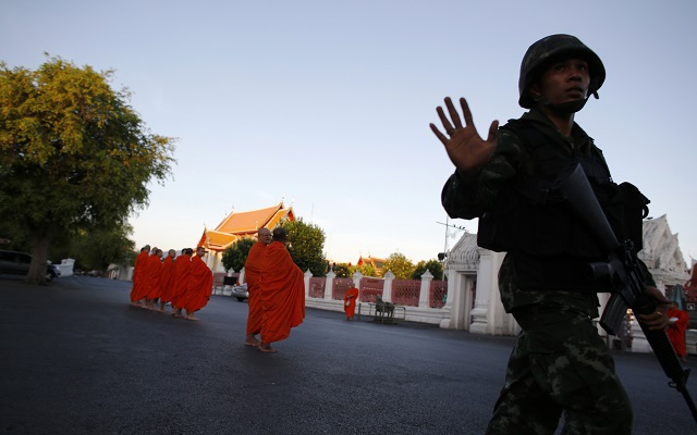 Thai soldier stands guard outside a temple near Government House in Bangkok