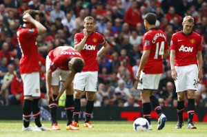 Manchester United captain Nemanja Vidic and his players react after conceding a goal to Sunderland during their English Premier League soccer match at Old Trafford in Manchester