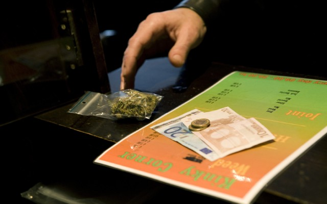 A customer pays for a bag of marijuana at a coffee shop in the southern Dutch city of Bergen op Zoom