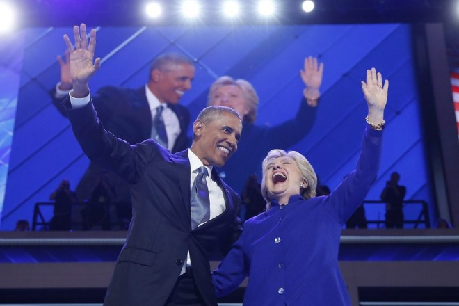 epa05444863 United States President Barack Obama and Democratic Nominee for President Hillary Clinton, wave after addressing the delegates on the third day of the Democratic National Convention at the Wells Fargo Center in Philadelphia, Pennsylvania, USA, 26 July 2016. The four-day convention is expected to end with Hillary Clinton formally accepting the nomination of the Democratic Party as their presidential candidate in the 2016 election.  EPA/JUSTIN LANE