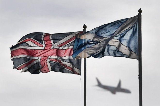 epa05846268 The Union Flag (L) and the Saltire, the national flag of Scotland (R), fly over Whitehall in London, Britain, 13 March 2017.  Scotland's First Minister Nicola Sturgeon announced during a speech 13 March that she will seek permission for a second Independence Referendum. It was reported to most likely be held in late 2018 or the spring of 2019.  EPA/ANDY RAIN
