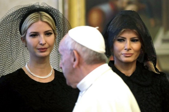epa05985637 Pope Francis (C) walks past Ivanka Trump (L) and US First Lady Melania Trump (R) during his meeting with US President Donald J. Trump in Vatican City, 24 May 2017. Trump is in Italy on a two day visit, including a meeting with Pope Francis at the Vatican, ahead of his participation in a NATO summit in Brussels on 25 May.  EPA/ALESSANDRA TARANTINO / POOL