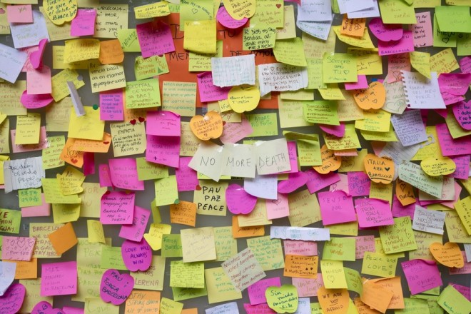 epa06151116 Post-it notes are pasted to a wall at the La Rambla, in Barcelona, Spain, 19 August 2017. At least 14 people were killed and some 130 others injured after cars crashed into pedestrians on the Las Ramblas boulevard in Barcelona and on a promenade in the coastal city of Cambrils on 17 August. Spanish police have stated that the attacks in Barcelona and in Cambrils were linked. The so-called 'Islamic State' (IS) in the meantime has claimed responsibility for the attacks in Barcelona and Cambrils. Spanish police are still hunting for the driver of a van who perpetrated the deadly attack in Barcelona.  EPA/MARTA PEREZ