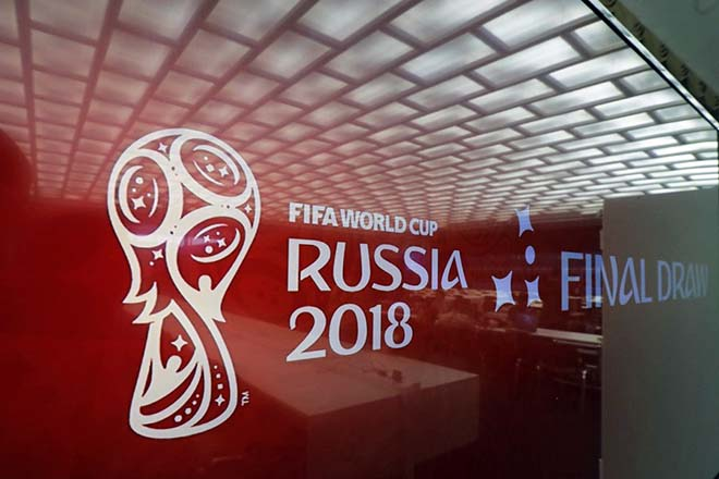 epa06355175 The logo of the FIFA World Cup 2018 in Russia displayed on a TV screen in the media centre in the State Kremlin Palace in Moscow, Russia, 28 November 2017. The Final Draw for the FIFA World Cup 2018 in Russia will take place in Moscow on 01 December 2017.  EPA/SERGEI ILNITSKY