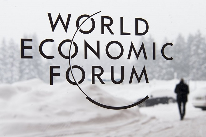 epa06460596 The Logo of the 48th annual meeting of the World Economic Forum, WEF, is seen on a window in Davos, Switzerland, 21 January 2018. The meeting brings together enterpreneurs, scientists, chief executive and political leaders in Davos from 23 to 26 January.  EPA/GIAN EHRENZELLER
