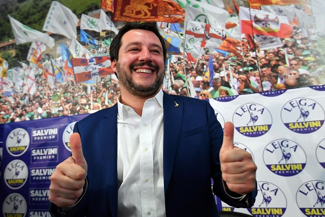 epa06582178 Federal Secretary of Italian party 'Lega' (League), Matteo Salvini, flashes a 'Thumbs-up' gesture during his press conference at the party's headquarter in Milan, Italy, 05 March 2018. League leader Matteo Salvini hailed his anti-migrant and Euroskeptic party's getting almost 18 percent of the vote compared to the 19 percent for the ruling centre-left Democratic Party (PD) and just 14 percent for his own coalition partner 'Forza Italia' led by three-times former Italian Prime Minister and media magnate Silvio Berlusconi.  EPA/DANIEL DAL ZENNARO