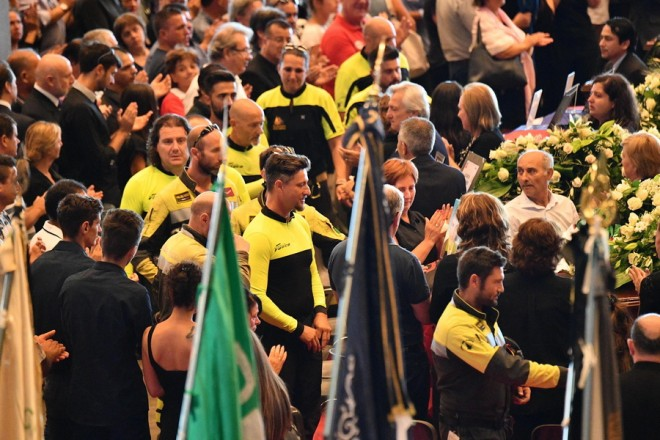 epa06955490 Italian firefighters are applauded as they pay homage to the victims of the Genoa highway-bridge-collapse disaster, prior to the State funeral at the Fiera di Genova exhibition center, in Genoa, Italy, 18 August 2018. The Morandi bridge partially collapsed on 14 August, killing at least 41 people.  EPA/LUCA ZENNARO