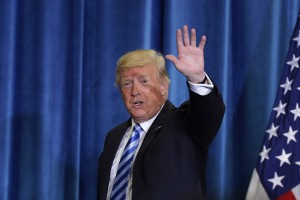 epa07119773 US President Donald J. Trump waves before leaving the Department of Health and Human Services where he announced a plan to overhaul how Medicare pays for certain drugs in Washington, DC, USA, 25 October 2018. According to reports, claiming that global freeloading has driven up drug costs, Trump said his plan could save Medicare more than 17 billion US dollars over five years, with the cost of some drugs dropping by as much as 30 percent.  EPA/CHIP SOMODEVILLA / POOL AFP OUT