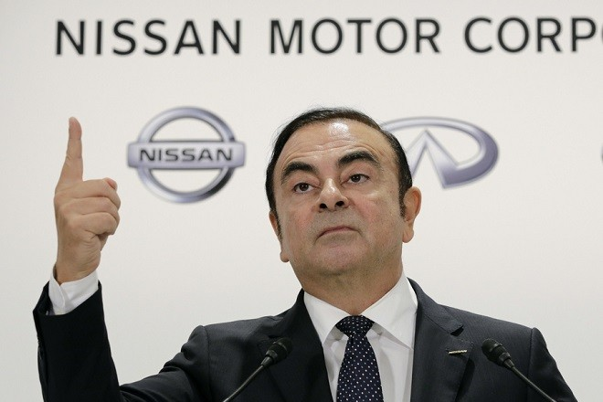 epa07220932 (FILE) - Carlos Ghosn, Chairman and Chief Executive Officer (CEO) of Nissan Motor Co., Ltd., speaks during a news conference in Tokyo, Japan, 20 October 2016 (reissued 10 December 2018) after attending a joint news conference with Osamu Masuko, Chairman, President and Chief Executive Officer of Mitsubishi MotorsCorp. Nissan has dismissed chairman Carlos Ghosn from his post over financial misconduct claims after conducting an internal investigation which showed Mr Ghosn had been allegedly under-reporting his income and used company funds for personal expenditures. Automobile maker Nissan has also been charged under the indictment.  EPA/KIMIMASA MAYAMA