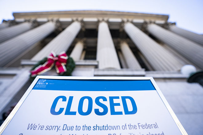 epa07249304 A sign alerts visitors to the closure of the National Archives on the fifth day of a partial government shutdown in Washington, DC, USA, 26 December 2018. Last week, President Trump rejected a Senate-passed continuing resolution to fund the federal government because it did not include money for his border wall. Though President Trump said he was 'proud' to shut the government down, lawmakers will meet again later this week to attempt to negotiate a way around the stalemate.  EPA/JIM LO SCALZO