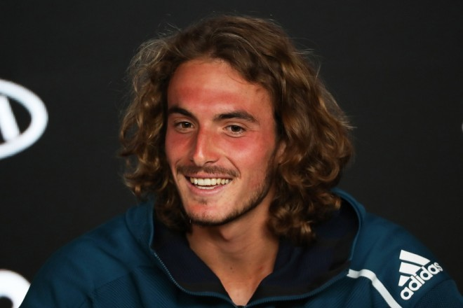 epa07308175 Stefanos Tsitsipas of Greece speaks during a press conference after winning his men's singles quarter final match against Roberto Bautista Agut of Spain at the Australian Open Grand Slam tennis tournament in Melbourne, Australia, 22 January 2019.  EPA/DAVID CROSLING AUSTRALIA AND NEW ZEALAND OUT