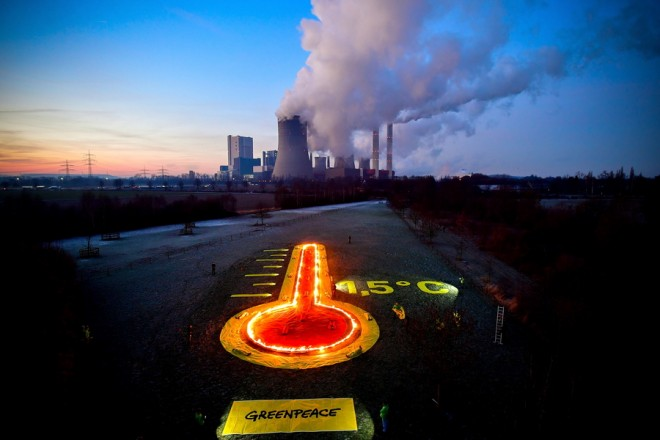 epa07308197 Greenpeace activists display a thermometer installation in front of the brown coal-fired power plant Niederaussem operated by RWE in Bergheim, 22 January 2019. The Rhenish Brown Coal Field is Europe's largest carbon dioxide source. Greenpeace activists demanded for a better climate protection.  EPA/SASCHA STEINBACH