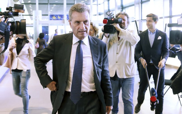 EU Commissioner Oettinger arrives for an EU-Russia-Ukraine trilateral energy meeting in Brussels