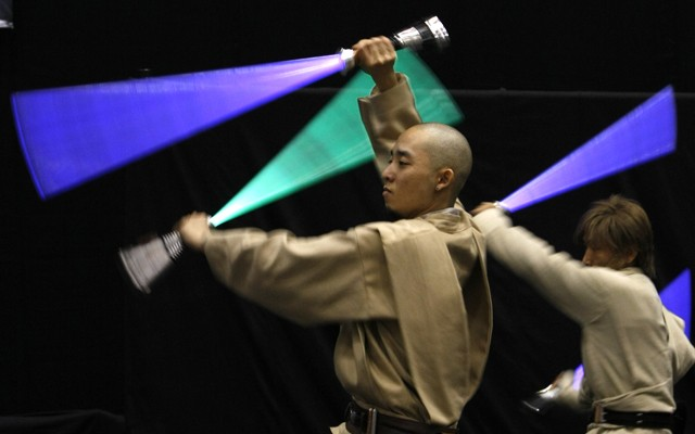 "Participants dressed as Jedi Knights perform at ""Star Wars Celebration Japan' in Chiba"