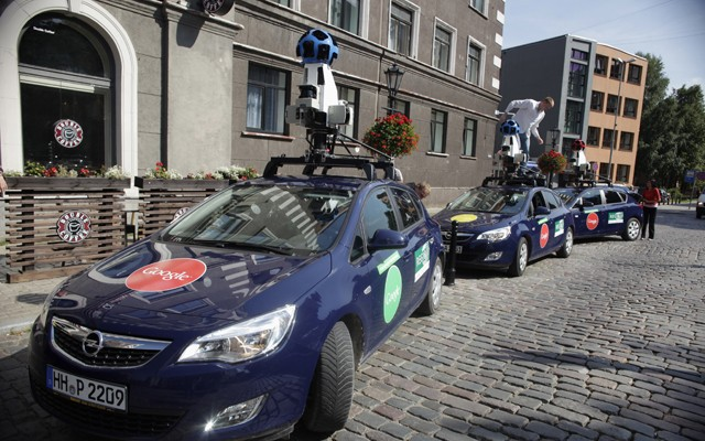 Specialists set up Google Street View cars for a media event in Riga