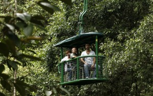 Tourists take an aerial tram ride in the rainforest tram at the Braullio Carrillo National Park