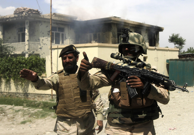 Members of the Afghan security force arrive at scene after Taliban fighters stormed a government building in Jalalabad