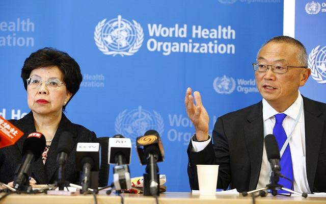 WHO Director-General Margaret Chan sits next to Fukuda, WHO's assistant director general for health security, as he addresses the media in Geneva