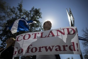 A man holds a placard during a rally in support of Scotland's independence referendum, in Donetsk