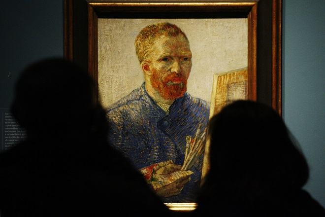 Visitors look at Vincent Van Gogh's Self Portrait as an Artist 1888, during the launch of The Real Van Gogh: The Artist and His Letters exhibition at the Royal Academy of Arts in London