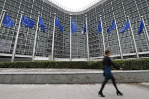 A woman walks past the European Commission headquarters in Brussels