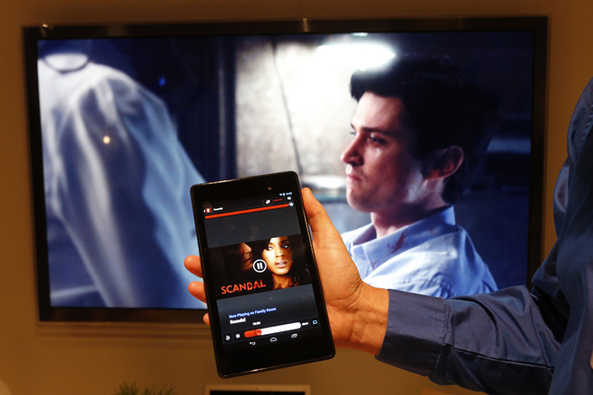 Michael Sundermeyer, of Google, demonstrates Google's new Chromecast device synching between a television and the new Nexus 7 tablet during a Google event at Dogpatch Studio in San Francisco