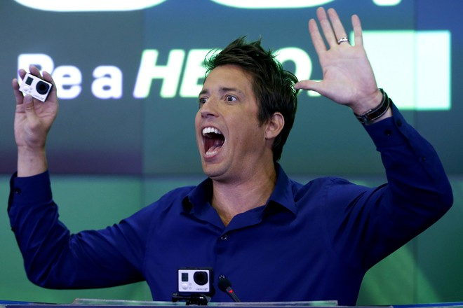 GoPro Inc's founder and CEO Woodman holds a GoPro camera as he celebrates GoPro Inc's IPO at the Nasdaq Market Site in New York