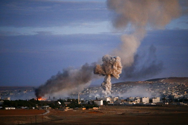 Smoke and flames rise over Syrian town of Kobani after an airstrike