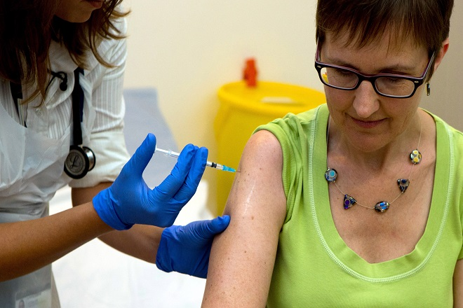Volunteer Ruth Atkins receives an injection of the ebola vaccine at the Oxford Vaccine Group Centre for Clinical Vaccinology and Tropical Medicine in Oxford