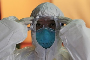 A health workers wears a protective suit and goggles during an Ebola response training session in Alabang