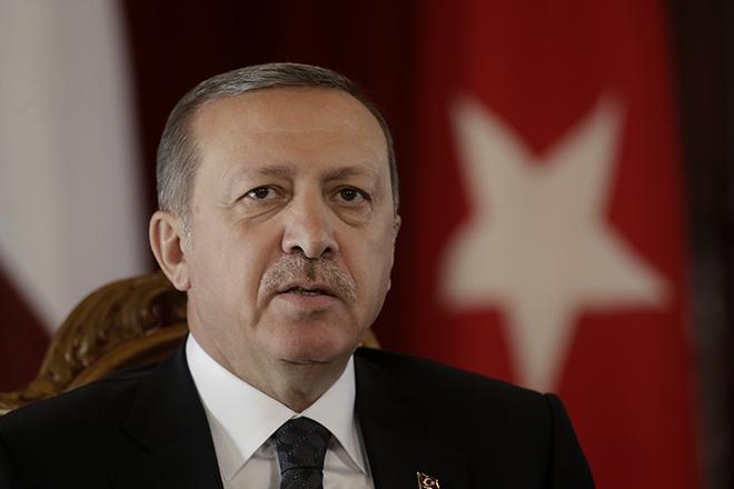 Turkey's President Erdogan speaks during a news conference in Riga