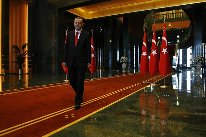 Turkey's President Tayyip Erdogan leaves an official ceremony to mark Republic Day at the new Presidential Palace in Ankara