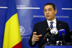 Romania's Prime Minister Ponta gestures during a news conference at the Foreign Ministry in Bucharest