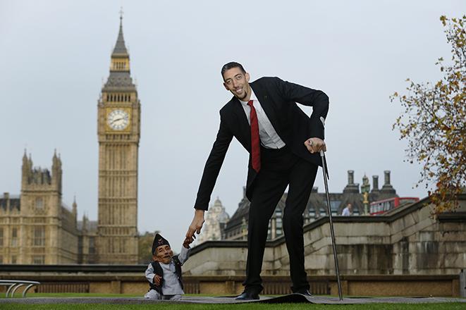 The world's shortest man Chandra Bahadur Dangi greets the tallest living man Sultan Kosen to mark the Guinness World Record's Day in London